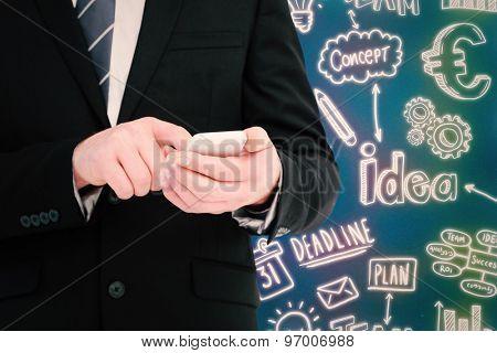 Businessman sending a text message against blue background