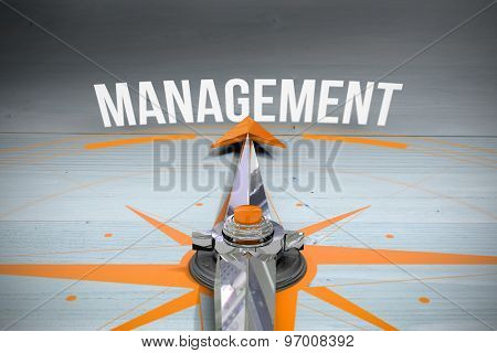 The word management and compass against bleached wooden planks background