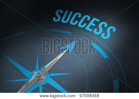 The word success and compass against grey