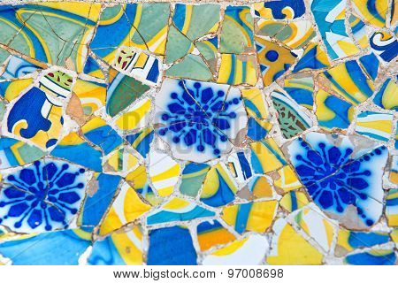 BARCELONA, SPAIN - MAY 02: Gaudis mosaic work on the main terrace at Parc Guell. Park Guell is a public park system composed of gardens and architectonic elements. Barcelona, Spain, May 02 2015