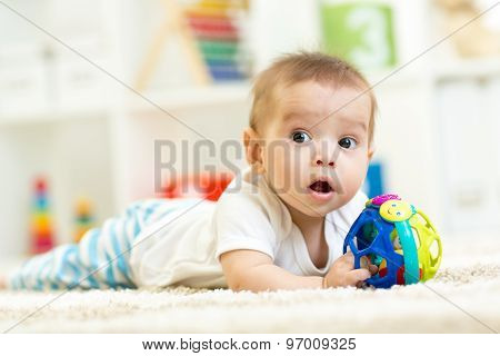 baby playing on a carpet at home