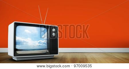 Retro television against beach
