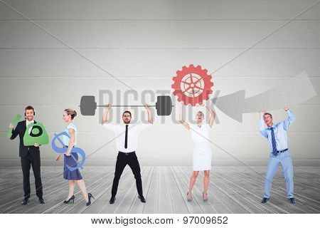 Business people holding icons against grey room