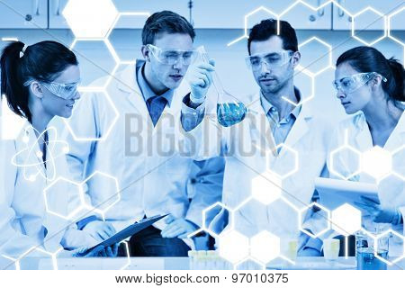 Scientists working on an experiment at the laboratory against science graphic