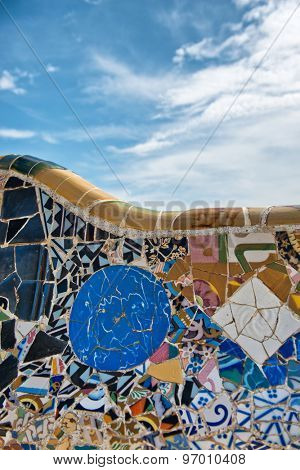 BARCELONA, SPAIN - MAY 02: Gaudi­'s mosaic work on the main terrace at Parc Guell. Park Guell is a public park system composed of gardens and architectonic elements. Barcelona, Spain, May 02 2015