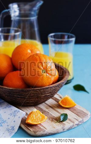 Ripe Oranges In A Wooden Bowl