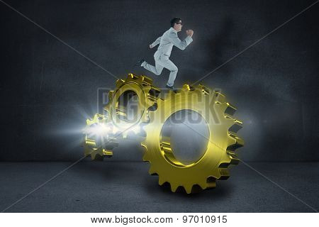 Geeky happy businessman running mid air against black wall