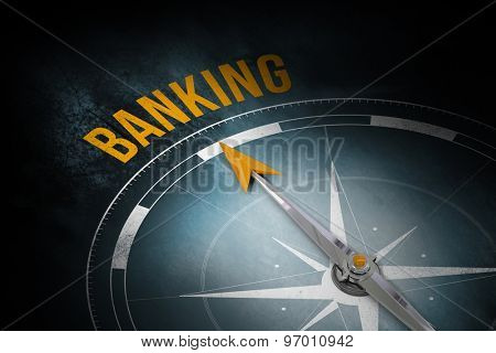 The word banking and compass against dark background