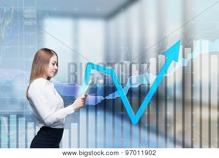 Young Thoughtful Lady Is Searching Something In The Internet Using The Tablet. Financial Charts And