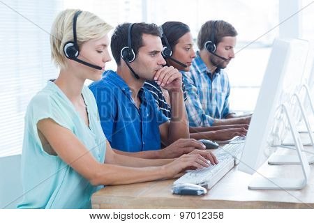 Attentive call center workers on their laptops
