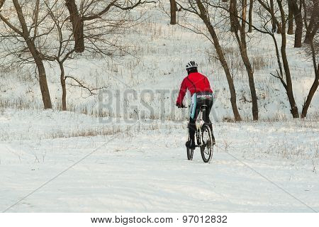 Professional mountain cyclist in winter training on the local hills