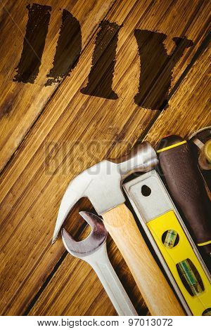 The word diy against desk with tools