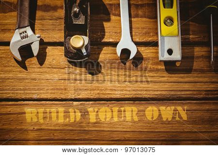 The word build your own against tools on desk
