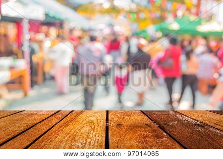 Blurred Image Of People Walking At Day Market  In Sunny Day, Blur Background With Bokeh.