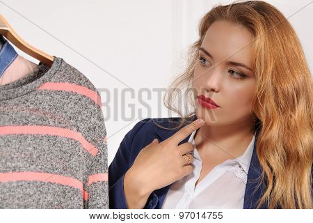 Woman In Formal Wear Chooses Shirt