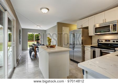 Modernized Kitchen With Grey And White Theme.