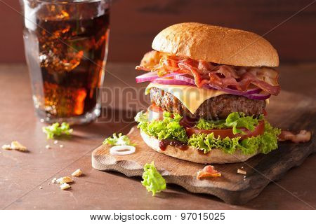 bacon cheese burger with beef patty tomato onion cola