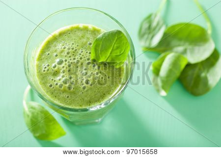healthy green smoothie with spinach leaves