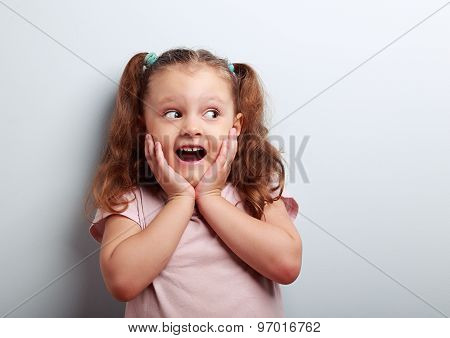 Fun Surprising Kid Girl With Open Mouth Looking On Empty Copy Space