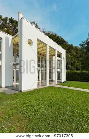 green garden of a white modern villa, external