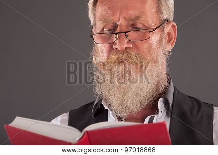 Man With Beard Reding A Book