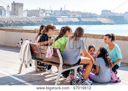 A Group Of Spanish, Female Teenagers Meet After School To Talk Together