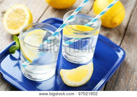 Fresh Lemonade With Lemon On Grey Wooden Background