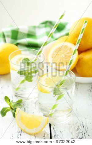 Fresh Lemonade With Lemon On White Wooden Background