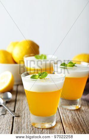 Tasty Lemon Jelly In Glass On Grey Wooden Background