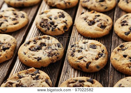 Chocolate Chip Cookies On Brown Wooden Background