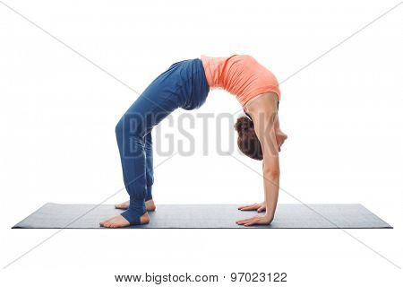 Beautiful sporty fit yogini woman practices yoga asana chakrasana (or urdva dhanurasana)  - wheel pose (or upward facing bow) pose isolated on white