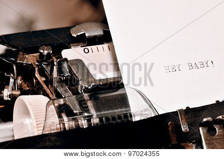 Text Hey Baby Typed On Old Typewriter