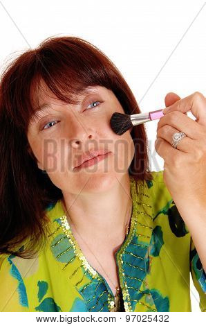 Woman Putting Makeup On Her Chic's.
