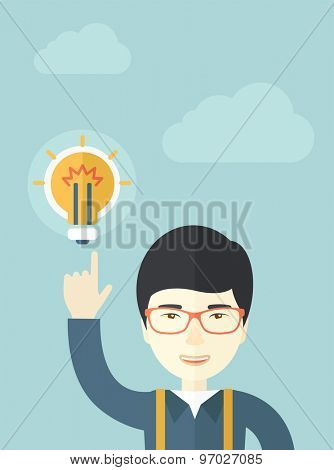 A happy asian guy raising his hand pointing the bulb having a good idea for business. Business concept. A Contemporary style with pastel palette, soft blue tinted background with desaturated clouds
