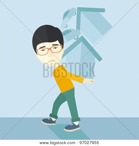 A sad chinese man carrying house and car as his loan or debt from the bank. A Contemporary style with pastel palette, soft blue tinted background. Vector flat design illustration. Square layout.
