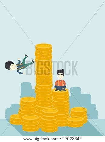 A Two asian businessmen one sitting with self confidence on the top of a coin while the other one, competitor feel sad on his falling down from higher piled coin as a symbol of unsuccessful business