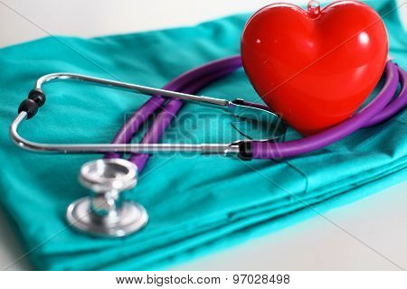 Stethoscope on a background of medical coat