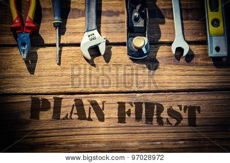 The word plan first against desk with tools