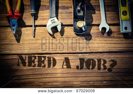 The word need a job? against desk with tools