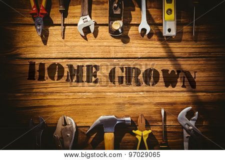 The word home grown against desk with tools