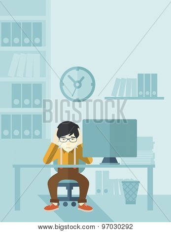 An overworked japanese businessman sitting in front of computer holding his head by two hands, under stress causing a headache. Unhappy concept. A contemporary style with pastel palette soft blue