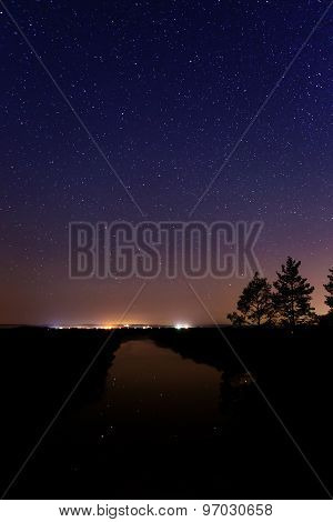 Smooth Surface Of The River On A Background The Starry Sky