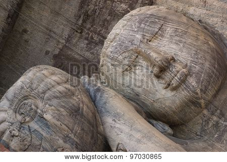 Closeup of reclining Buddha statue at Gal vihare Polonnaruwa Sri Lanka
