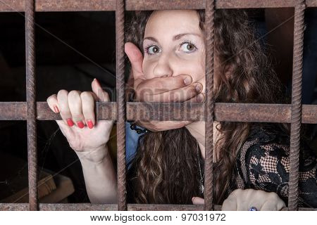 Woman Hostage Behind Bars