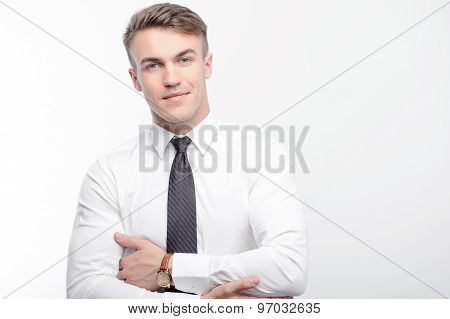 Businessman with crossed arms isolated background