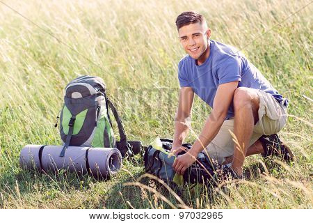 Young tourist in the field