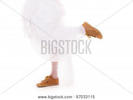 Wedding. Running Bride Woman Legs In Sport Shoes