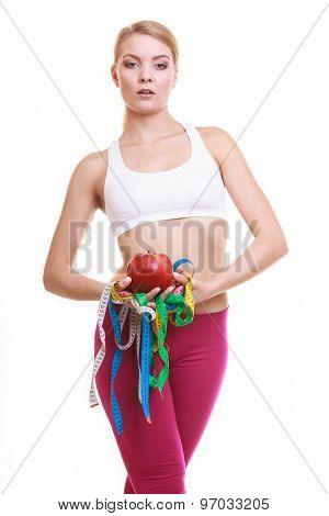 Happy Woman Holding Apple And Tape Measures.