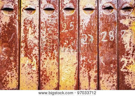 old rusty iron mailboxes with house numbers