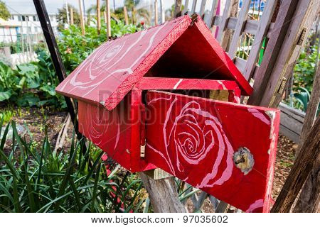 Red Wooden Letterbox With A Floral  Pattern